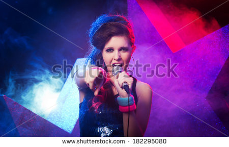 stock-photo-young-beautiful-girl-singing-on-stage-with-star-on-background-182295080